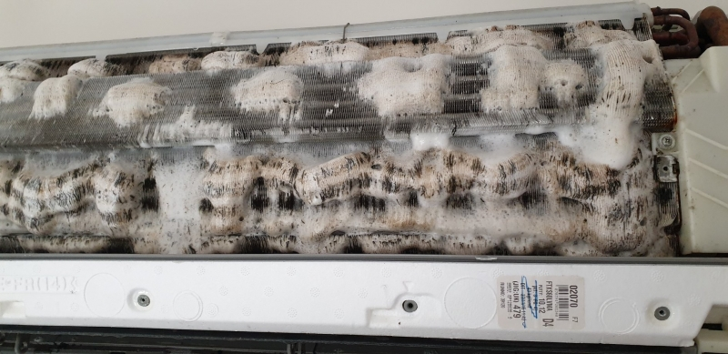 Foaming spray on an indoor AC coil - prepped for a Pressure Clean.